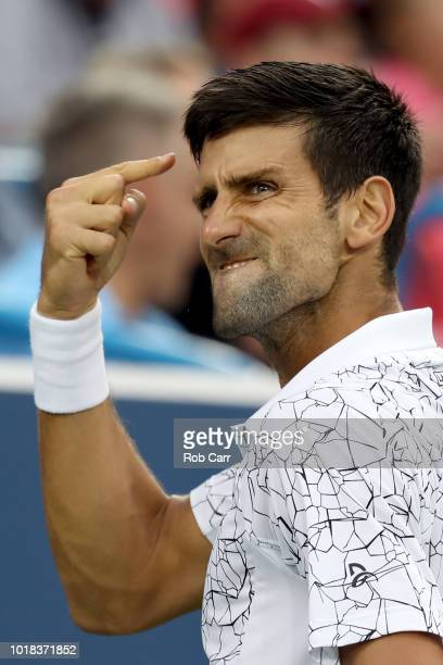 Novak Djokovic of Serbia celebrates a point against Milos Roanic of Canada during Day 7 of the Western and Southern Open at the Lindner Family Tennis...