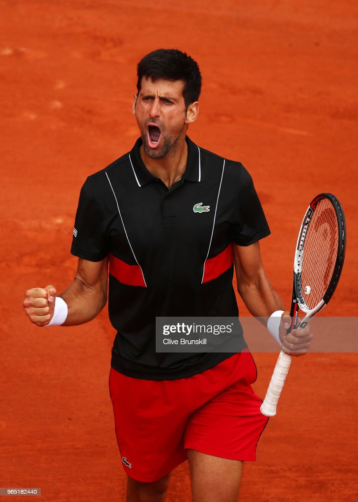 Novak Djokovic of Serbia celebrates a point duirng his mens singles third round match against Roberto Bautista Agut of Spain during day six of the 2018 French Open at Roland Garros on June 1, 2018 in Paris, France.