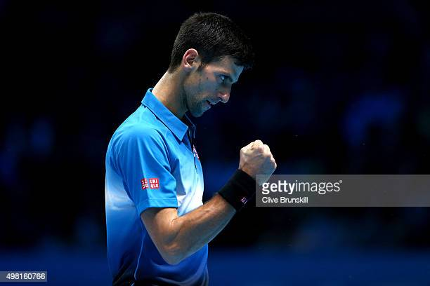 Novak Djokovic of Serbia celebrates a point during his straight sets victory against Rafael Nadal of Spain during the men's singles semi final match...