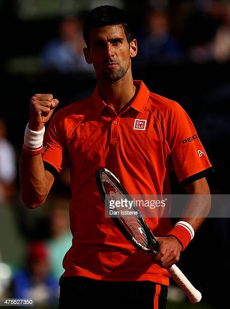 Novak Djokovic of Serbia celebrates a point in his Men's Singles match against Richard Gasquet of France on day nine of the 2015 French Open at...