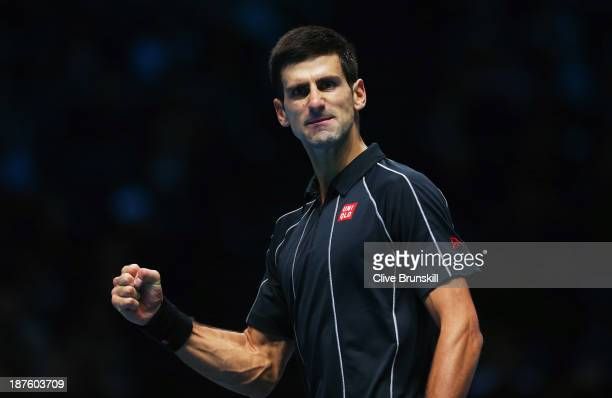 Novak Djokovic of Serbia celebrates a point in his men's singles semifinal match against Stanislas Wawrinka of Switzerland during day seven of the...