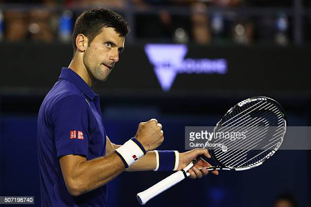 Novak Djokovic of Serbia celebrates a point in his semi final match against Roger Federer of Switzerland during day 11 of the 2016 Australian Open at...