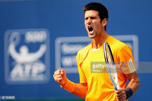 Novak Djokovic of Serbia celebrates a shot against Robin Soderling of Sweden in the Semifinals during day nine of the 2009 China Open at the National...