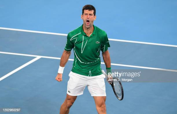 Novak Djokovic of Serbia celebrates a winning point during his semi final match victory against Roger Federer of Switzerland on day eleven of the...