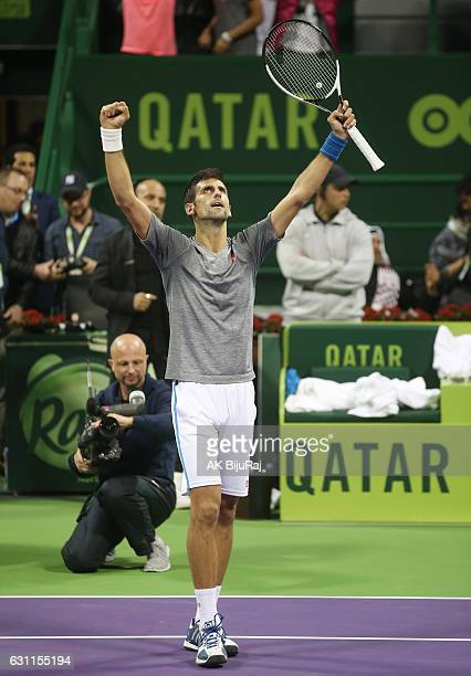 Novak Djokovic of Serbia celebrates after beating Andy Murray of Great Britain in the men's singles final match of the ATP Qatar Open tennis...
