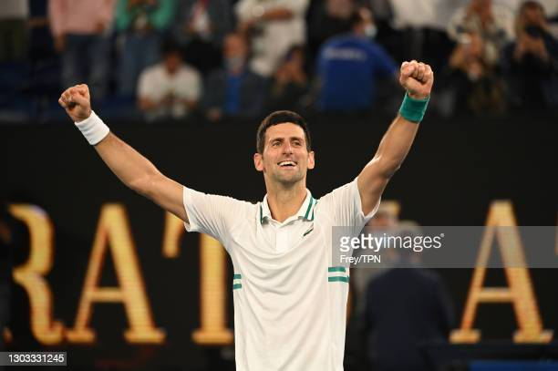 Novak Djokovic of Serbia celebrates after beating Daniil Medvedev of Russia in the men's singles final during day 14 of the 2021 Australian Open at...