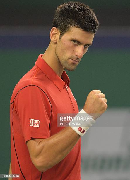 Novak Djokovic of Serbia celebrates after beating Fabio Fognini of Italy in their men's singles match in the Shanghai Masters tennis tournament in...