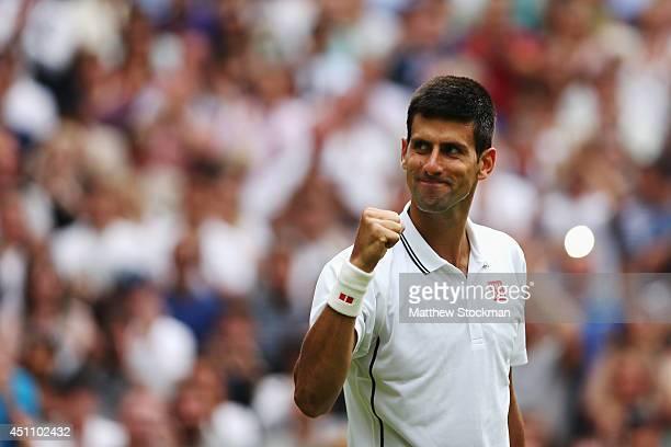 Novak Djokovic of Serbia celebrates after defeating Andrey Golubev of Kazakhstan in three straight sets during their Gentlemen's Singles first round...