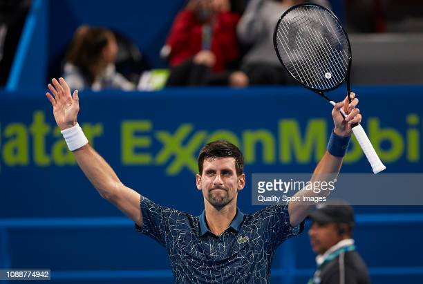 Novak Djokovic of Serbia celebrates after defeating Damir Dzumhur of Bosnia and Herzegovina during day two of the ATP Qatar ExxonMobil Open at...
