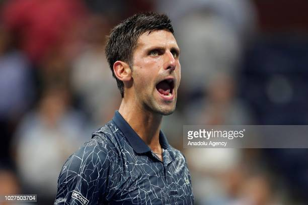 Novak Djokovic of Serbia celebrates after defeating John Millman of Australia during their Men's Singles QuarterFinals match at the 2018 US Open in...