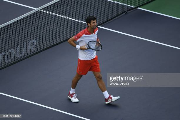Novak Djokovic of Serbia celebrates after defeating Marco Cecchinato of Italy in their men's singles third round match at the Shanghai Masters tennis...