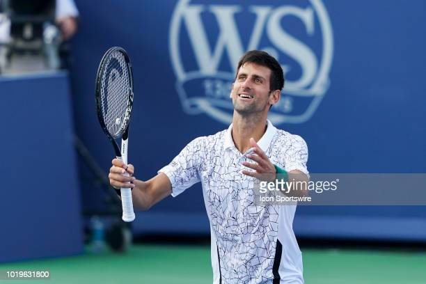 Novak Djokovic of Serbia celebrates after defeating Roger Federer of Switzerland in the Western Southern Open singles final at the Lindner Family...