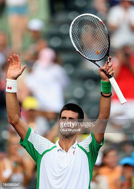 Novak Djokovic of Serbia celebrates after his straight victory against Somdev Devvarman of India during their third round match at the Sony Open at...