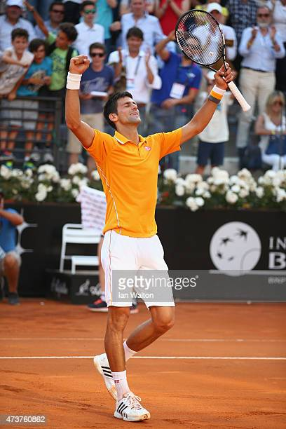 Novak Djokovic of Serbia celebrates after his victory over Roger Federer of Switzerland in the Men's Singles Final on Day Eight of The Internazionali...