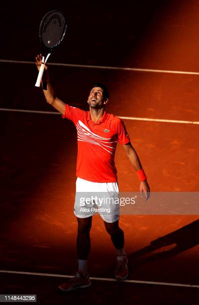Novak Djokovic of Serbia celebrates after match point in his men's singles semifinal match against Dominic Thiem of Austria during day eight of the...