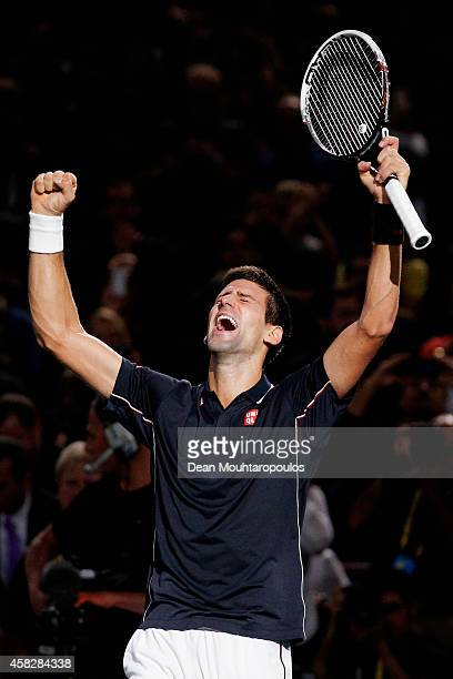 Novak Djokovic of Serbia celebrates after victory against Milos Raonic of Canada in their Final match during day 7 of the BNP Paribas Masters held at...