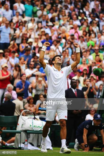 Novak Djokovic of Serbia celebrates after winning his Gentlemen's Singles third round match against Gilles Simon of France on day five of the...