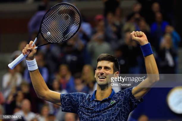 Novak Djokovic of Serbia celebrates after winning his Men's Singles final match against Juan Martin del Potro of Argentina on Day Fourteen of the...