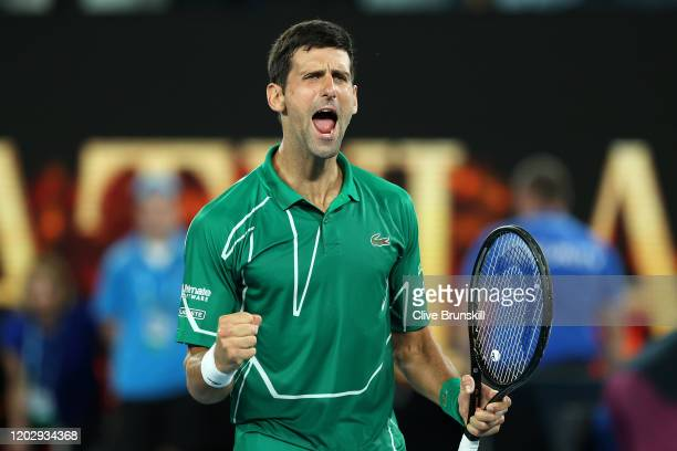Novak Djokovic of Serbia celebrates after winning his Men's Singles Semifinal match against Roger Federer of Switzerland on day eleven of the 2020...
