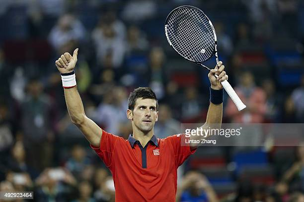 Novak Djokovic of Serbia celebrates after winning his men's singles quarterfinals match against Bernard Tomic of Australia on day 6 of Shanghai Rolex...
