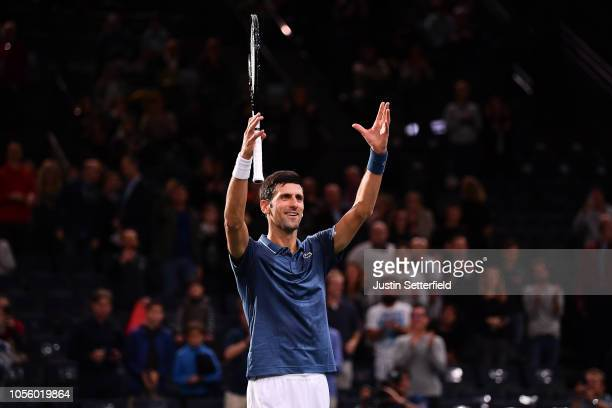 Novak Djokovic of Serbia celebrates after winning in his Round of 16 match against Damir Dzumhur of Bosnia who retired injured during Day 4 of the...