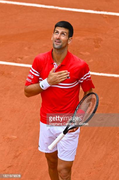 Novak Djokovic of Serbia celebrates after winning match point during his Men's Singles third round match against Ricardas Berankis of Lithuania on...