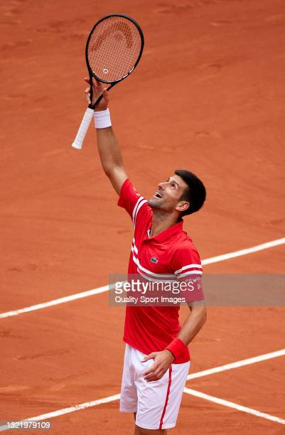 Novak Djokovic of Serbia celebrates after winning match point in his third round match against Ricardas Berankis of Lithuania during day seven of the...