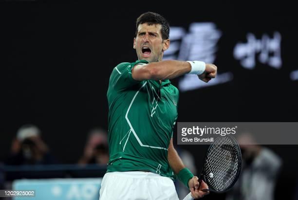 Novak Djokovic of Serbia celebrates after winning set point during his Men's Singles Semifinal match against Roger Federer of Switzerland on day...