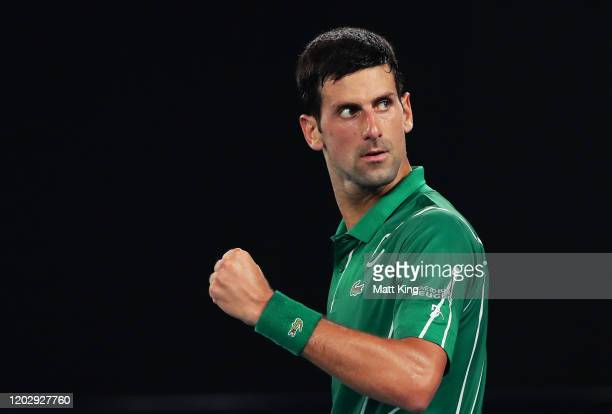 Novak Djokovic of Serbia celebrates after winning set point during his Men's Singles Semifinal match against Roger Federer of Switzerland on day...