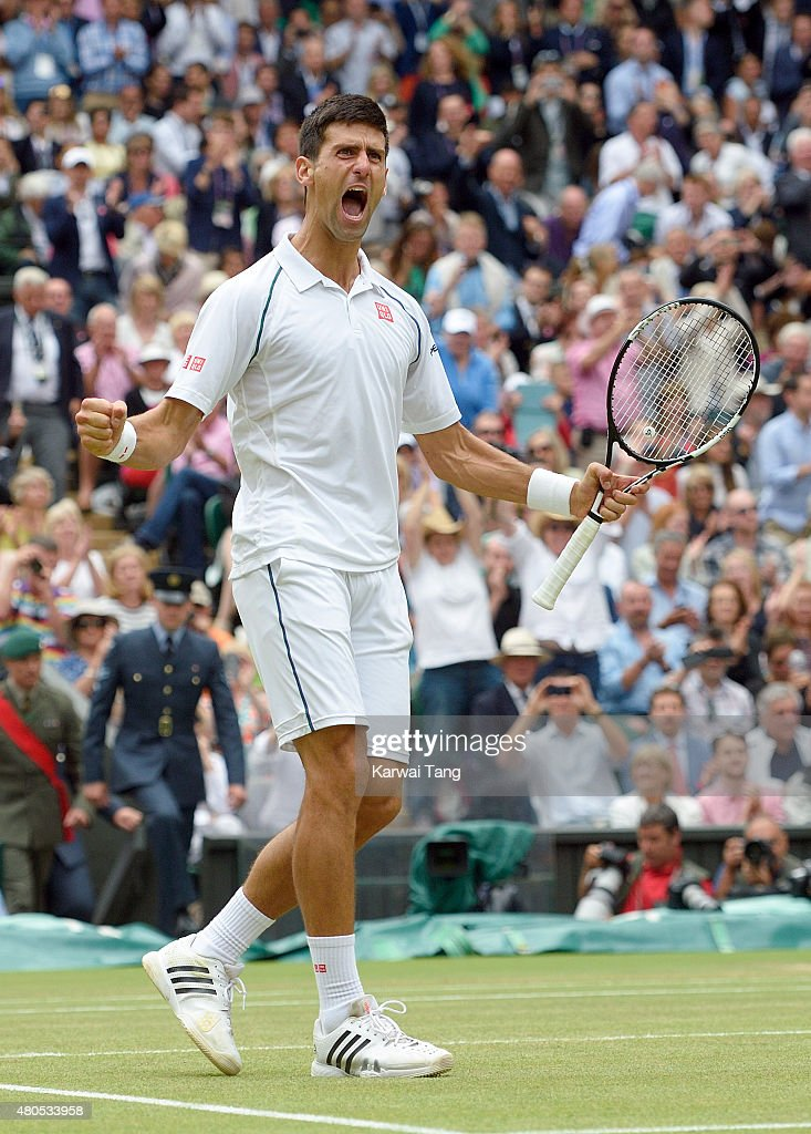 Novak Djokovic of Serbia celebrates after winning the Final Of The Gentlemen's Singles against Roger Federer of Switzerland on day 13 of the Wimbledon Tennis Championships at Wimbledon on July 12, 2015 in London, England.