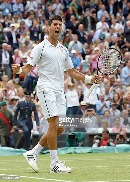Novak Djokovic of Serbia celebrates after winning the Final Of The Gentlemen's Singles against Roger Federer of Switzerland on day 13 of the...