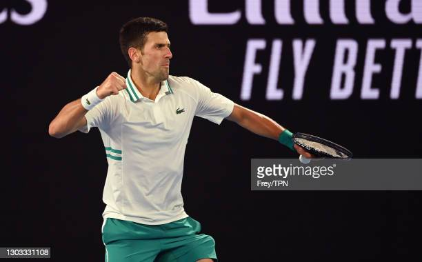 Novak Djokovic of Serbia celebrates against Daniil Medvedev of Russia in the men's singles final during day 14 of the 2021 Australian Open at...
