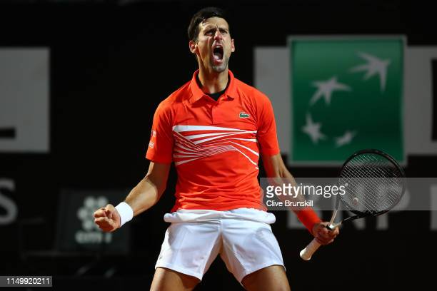 Novak Djokovic of Serbia celebrates against Juan Martin del Potro of Argentina in their Men's Single Quarter Final Match during Day Six of the...