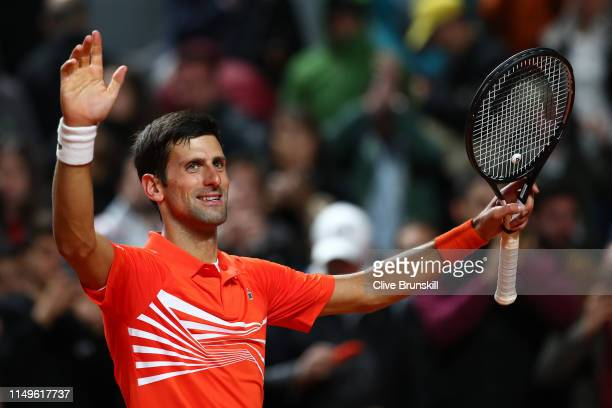 Novak Djokovic of Serbia celebrates against Philipp Kohlschreiber of Germany in their Men's Singles Round of 16 match during Day Five of the...