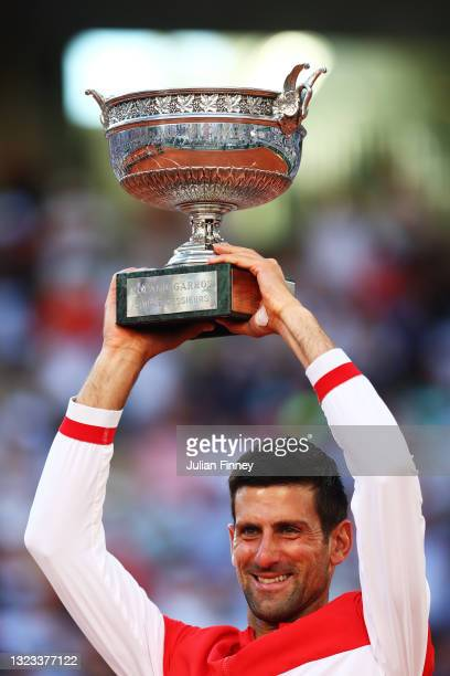 Novak Djokovic of Serbia celebrates as he lifts the trophy after winning his Men's Singles Final match against Stefanos Tsitsipas of Greece during...