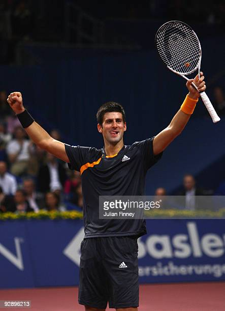 Novak Djokovic of Serbia celebrates at match point after defeating Roger Federer of Switzerland in the final during Day Seven of the Davidoff Swiss...