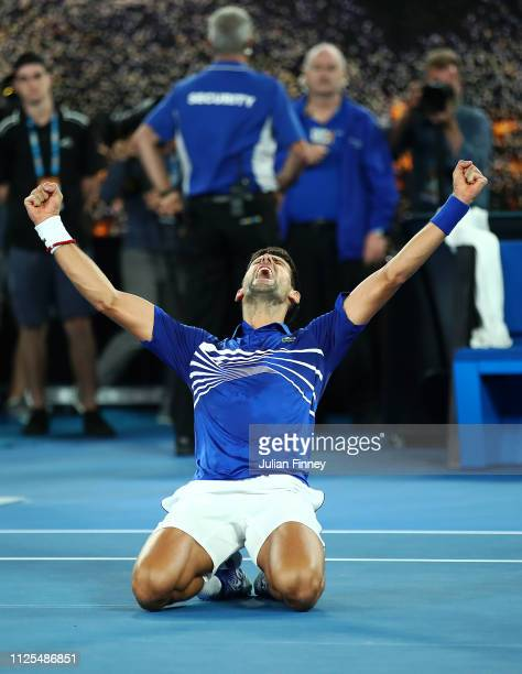 Novak Djokovic of Serbia celebrates at match point in his Men's Singles Final match against Rafael Nadal of Spain during day 14 of the 2019...