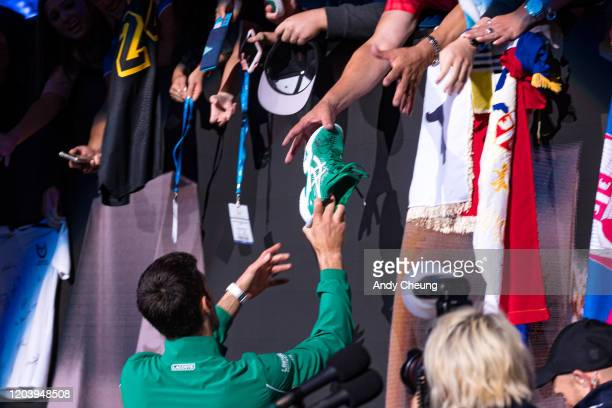 Novak Djokovic of Serbia celebrates at the trophy presentation ceremony after winning the men's singles final match against Dominic Thiem of Austria...