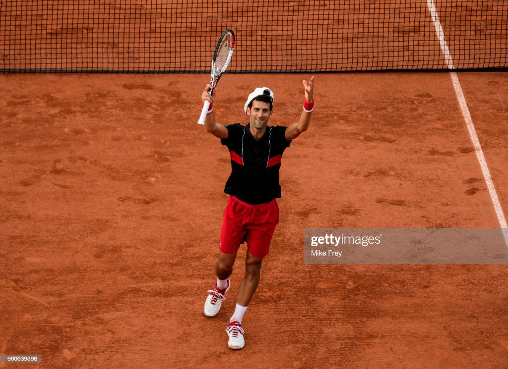 Novak Djokovic of Serbia celebrates beating Fernando Verdasco of Spain 6-3 6-4 6-2 in the fourth round of the men's singles at Roland Garros on day eight during the French Open on June 3, 2018 in Paris, France.