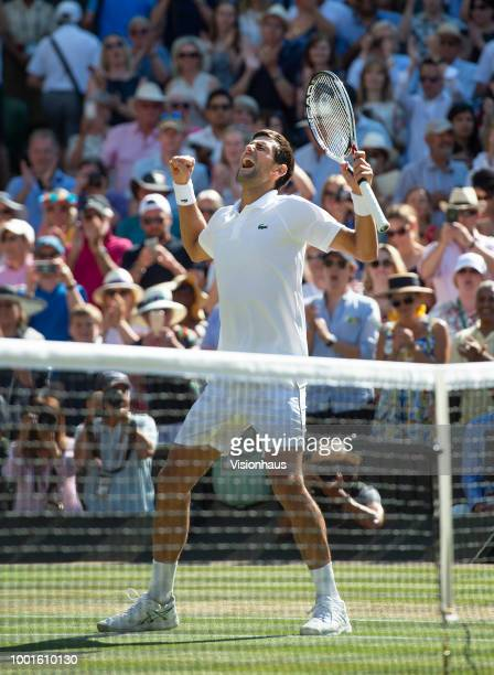 Novak Djokovic of Serbia celebrates beating Kevin Anderson of South Africa to win the Men's Singles Final on day thirteeen of the Wimbledon Lawn...
