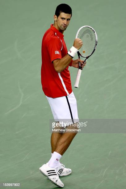 Novak Djokovic of Serbia celebrates breaking Tommy Haas of Germany during the Shanghai Rolex Masters at the Qi Zhong Tennis Center on October 12 2012...
