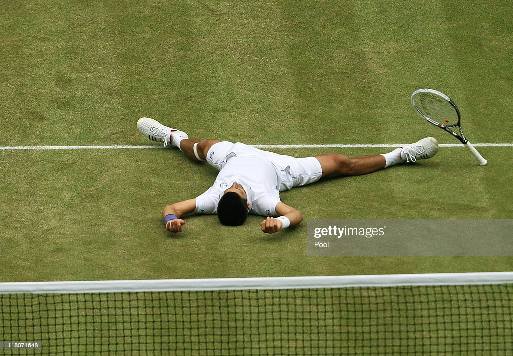 Novak Djokovic of Serbia celebrates championship point after winning his final round Gentlemen's match against Rafael Nadal of Spain on Day Thirteen of the Wimbledon Lawn Tennis Championships at the All England Lawn Tennis and Croquet Club on July 3, 2011 in London, England.