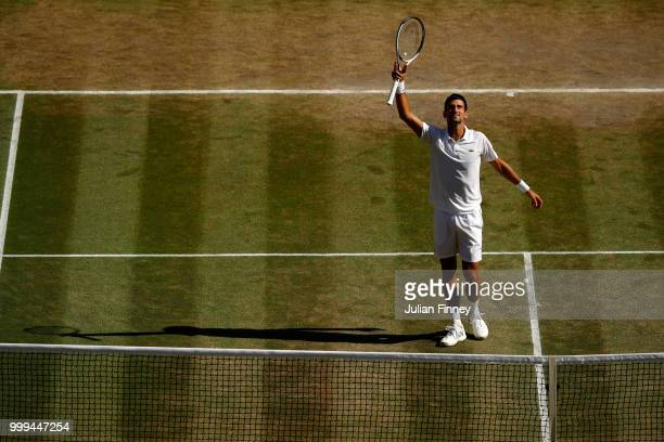 Novak Djokovic of Serbia celebrates Championship point against Kevin Anderson of South Africa during the Men's Singles final on day thirteen of the...
