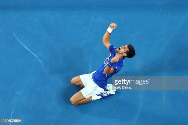 Novak Djokovic of Serbia celebrates championship point in his Men's Singles Final match against Rafael Nadal of Spain during day 14 of the 2019...