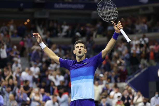 Novak Djokovic of Serbia celebrates defeating Alexander Zverev of Germany during their Men's Singles semifinal match on Day Twelve of the 2021 US...
