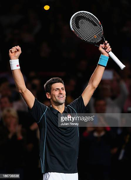Novak Djokovic of Serbia celebrates defeating David Ferrer of Spain in the final during day seven of the BNP Paribas Masters at Palais Omnisports de...