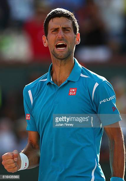Novak Djokovic of Serbia celebrates defeating JoWilfried Tsonga of France during day twelve of the BNP Paribas Open at Indian Wells Tennis Garden on...