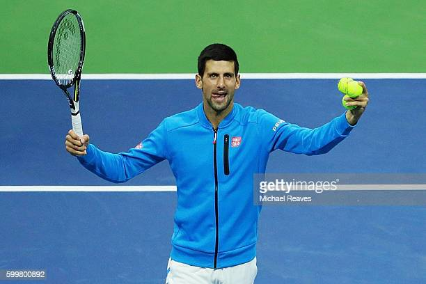 Novak Djokovic of Serbia celebrates defeating JoWilfried Tsonga of France during their Men's Singles Quarterfinals match on Day Nine of the 2016 US...