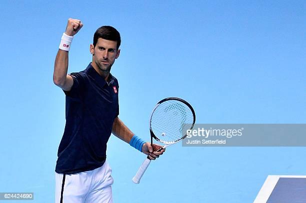 Novak Djokovic of Serbia celebrates defeating Kei Nishikori of Japan during their men's singles semi final on day seven of the ATP World Tour Finals...