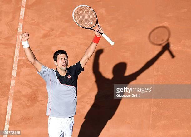 Novak Djokovic of Serbia celebrates defeating Milos Raonic of Canada during day seven of the Internazionali BNL d'Italia tennis 2014 on May 17 2014...